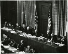 View_of_judges_panel_during_testimony_Nuremberg_Trials_1945-400x324