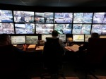 """Municipal police officers watch screens in the video surveillance control room of the municipal police supervision centre in Nice February 9, 2015. The Mayor of Nice visited the centre to launch the 1000th video camera as the highest level of """"Vigipirate"""" security plan was activated in Nice after three soldiers were attacked and two were wounded in a knife attack a week ago.   REUTERS/Eric Gaillard (FRANCE - Tags: POLITICS CRIME LAW) - RTR4OVUL"""