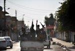 Syrian-Rebels-Patrol-Near-Turkey-400x271