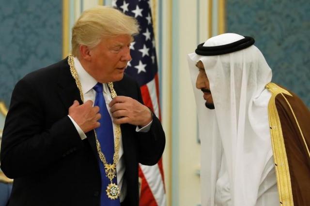Saudi Arabia's King Salman presents Trump with the Collar of Abdulaziz Al Saud Medal at the Royal Court in Riyadh